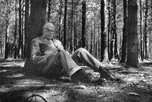 Thornton Wilder writing in the woods